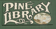 Sign that reads Pine Library